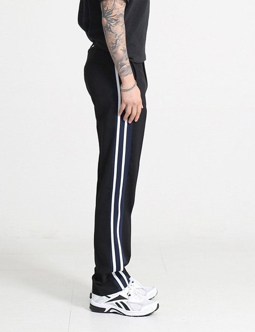 V. TAILORED TRACK TROUSERS